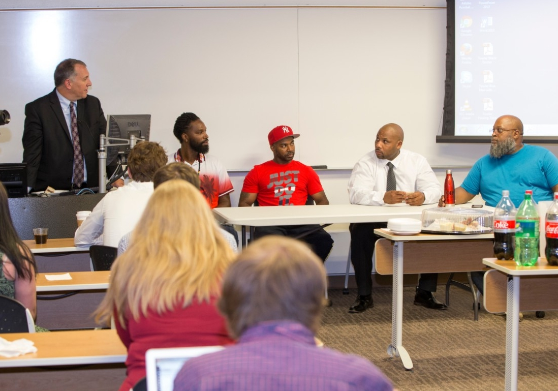 UC law professor Mark Godsey moderates a panel of exonerees who spoke to UC College of Law students.