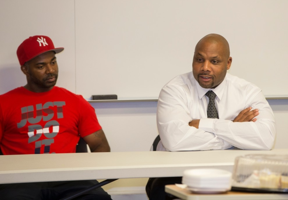 Laurese Glover, left, and Christopher Miller talk to UC students about their ordeals in proving their innocence. They were freed with help from UC's Ohio Innocence Project.
