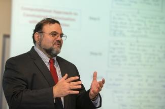 Kelly Cohen, professor of aerospace engineering, in his classroom.