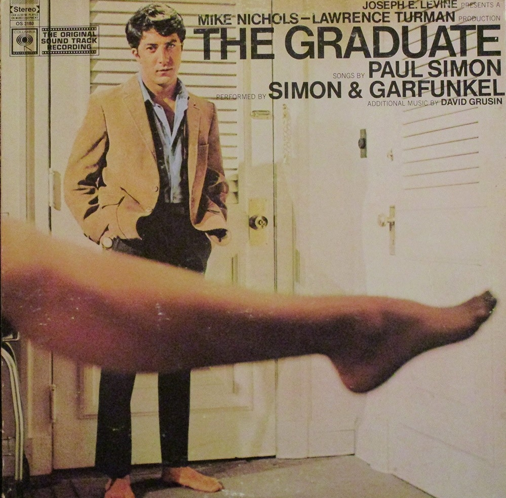 The album sleeve of the soundtrack to The Graduate with a young Dustin Hoffman and Anne Bancroft's leg in the foreground.