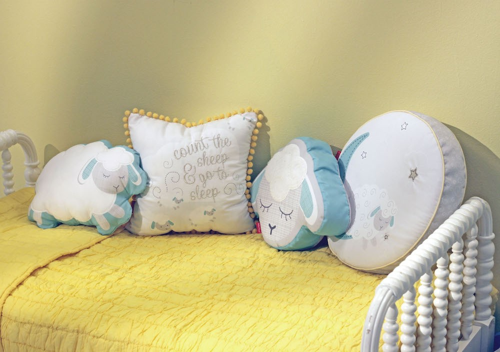 Blue, yellow and white sheep-themed children's pillows