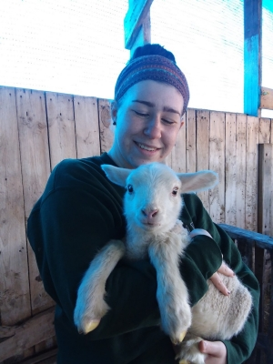 Young woman holding a lamb