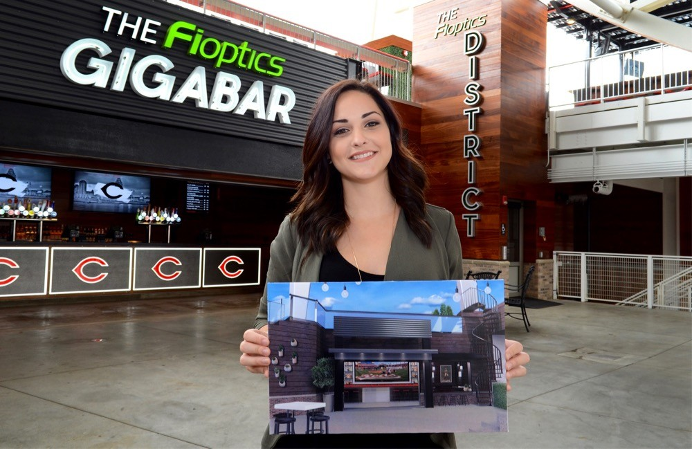 Amy Schigel holds her 3-D rendering of the design for Fioptics District Rooftop bar at Great American Ball Park. photo/Cincinnati Reds