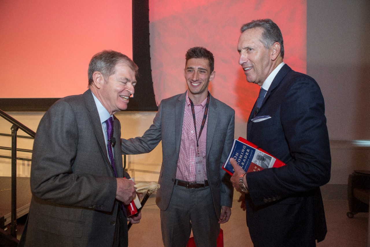 From left to right, Myron Ullman III, Jack FitzGerald, and Howard Schultz share a laugh after the conclusion of the Warren Bennis Leadership Experience