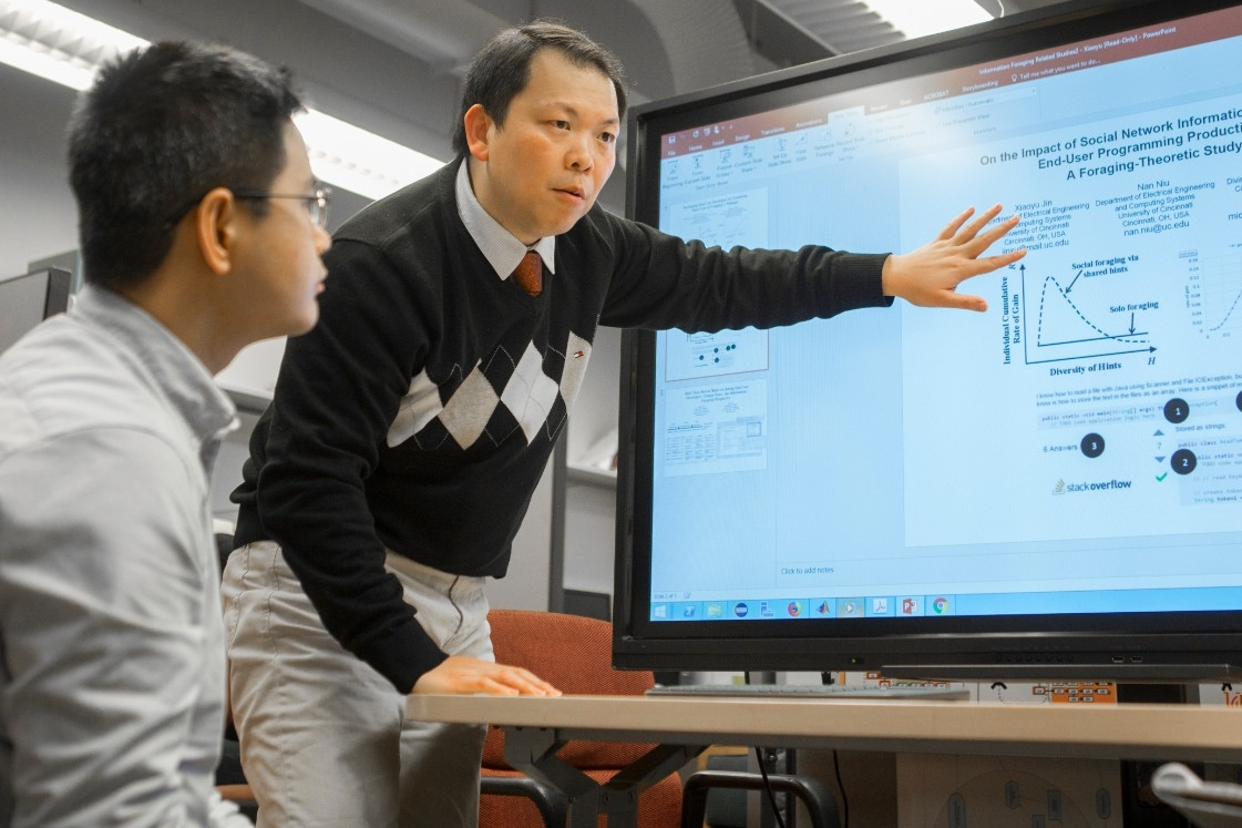 UC graduate student Xiaoyu Jin, left, and UC computer science professor Nan Niu found that software developers rarely found the code they needed all in one place.
