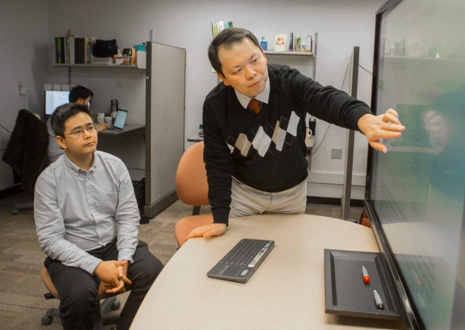 UC graduate student Xiaoyu Jin, left, and UC computer science professor Nan Niu studied the ways that software developers used the Internet to solve coding tasks.