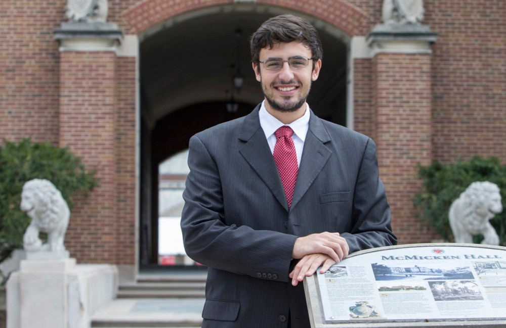 UC student Mohamed Elzarka standing in front of McMicken Hall. Photo/Andrew Higley/UC Creative Services
