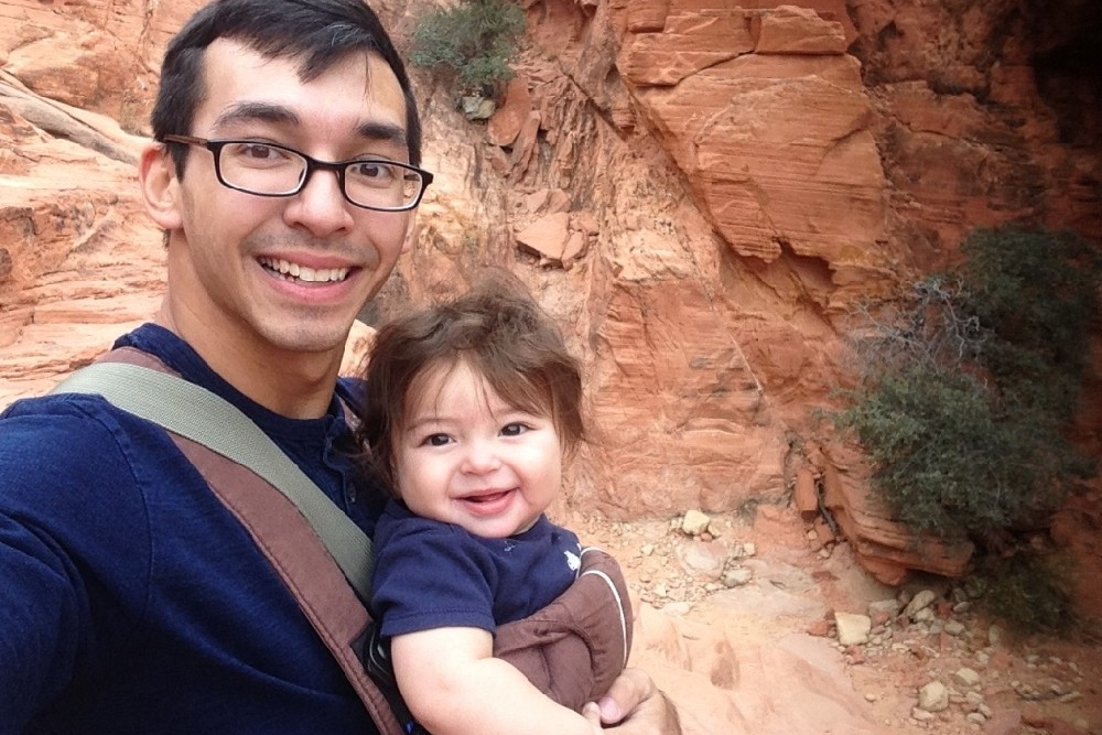UC student and 2017 Fulbright winner Corey-Levi Cloyd and his son in front of a large rock. photo/Corey-Levi Cloyd