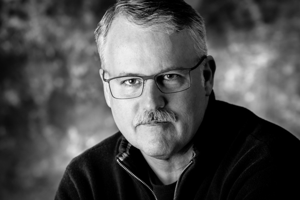 Black and white headshot of Barry Hutzel, who studied industrial design at DAAP from 1979-84.