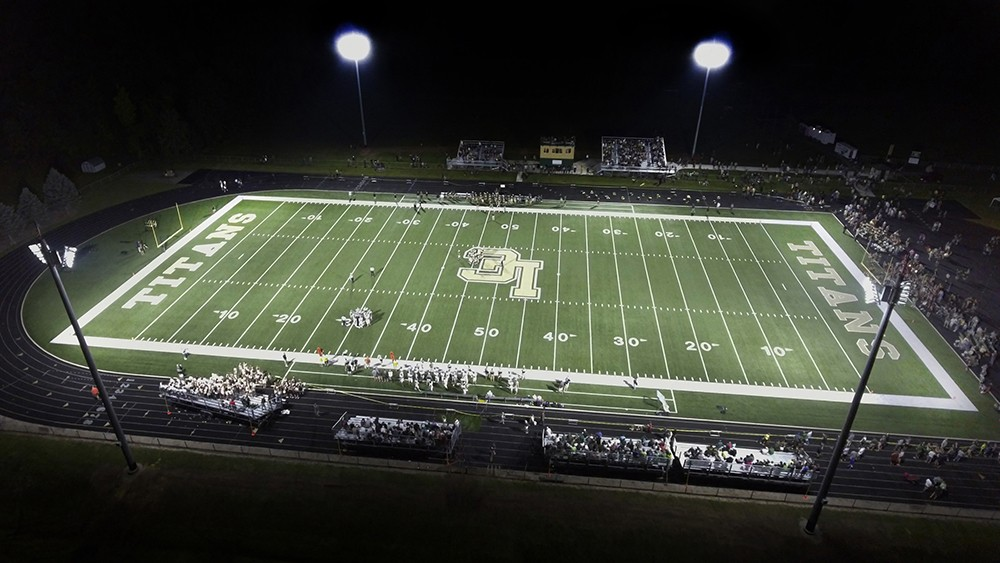 An overhead shot of an illuminated football field at night