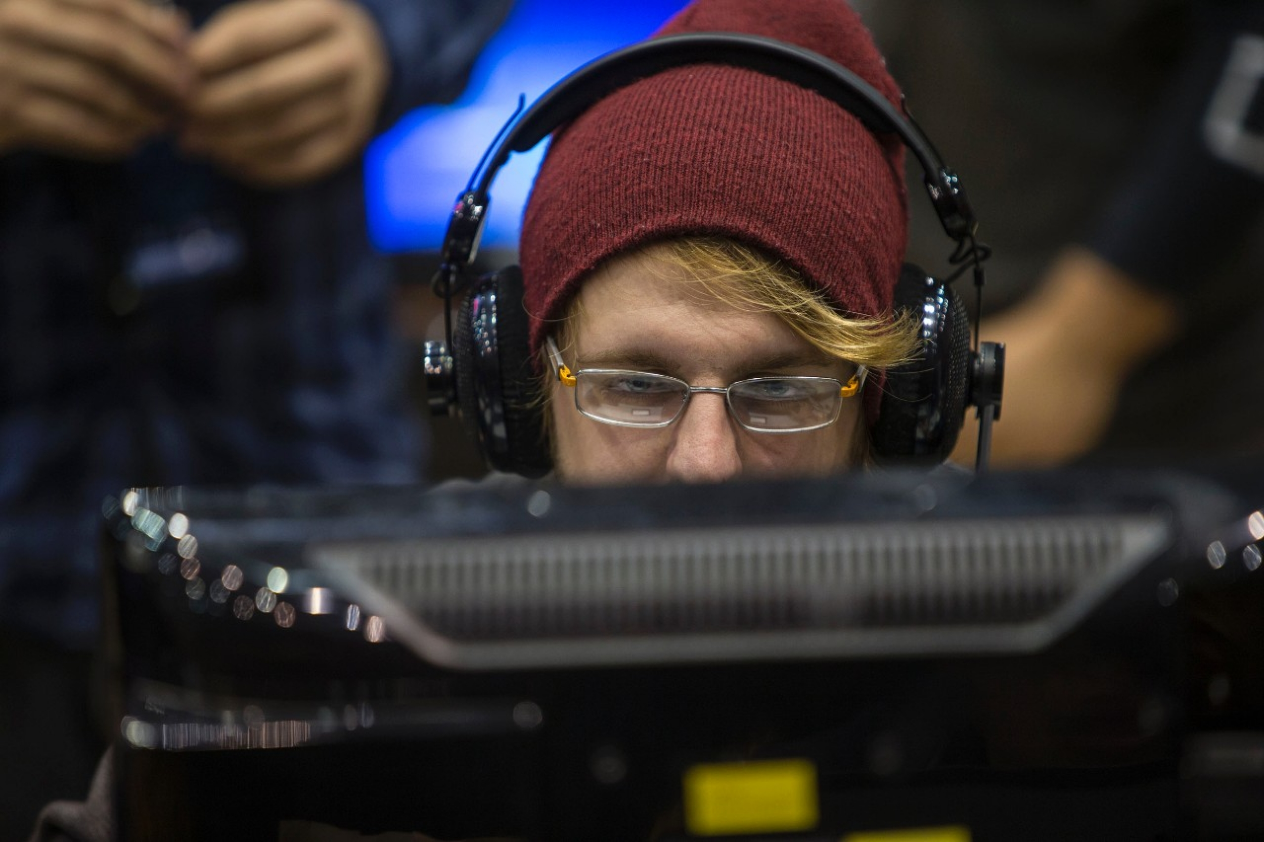 UC gamer stares at screen inside Fifth Third Arena