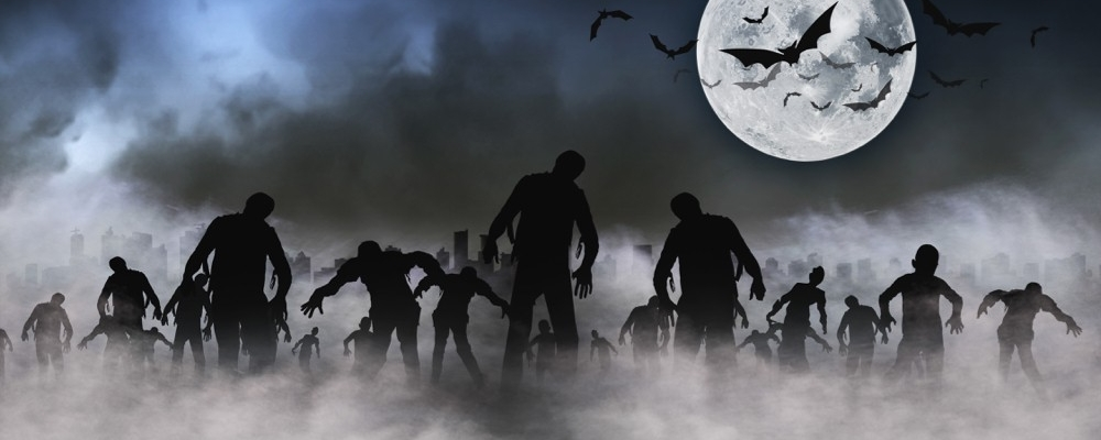 Zombies stroll through a smoke filled horizon under a full moon at Halloween