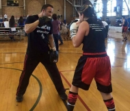 Harrington warms up with her coach, Kenny Christo, at the national tournament.