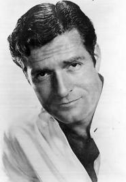 Portrait headshot of Hugh.