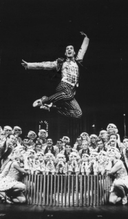 Lee Roy takes a giant leap into the air to jump over a group of performers in 42nd Street in 1981.