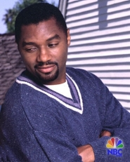 Rodney in a blue sweater on a set of his NBC soap opera Passions.