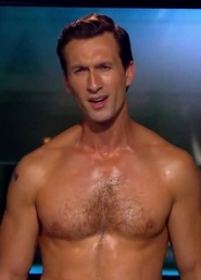Aaron wearing no shirt in a spoof episode of the Onion News Network.