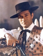 Wyatt Earp promo shot with Hugh wearing his outfit and cowboy hat.