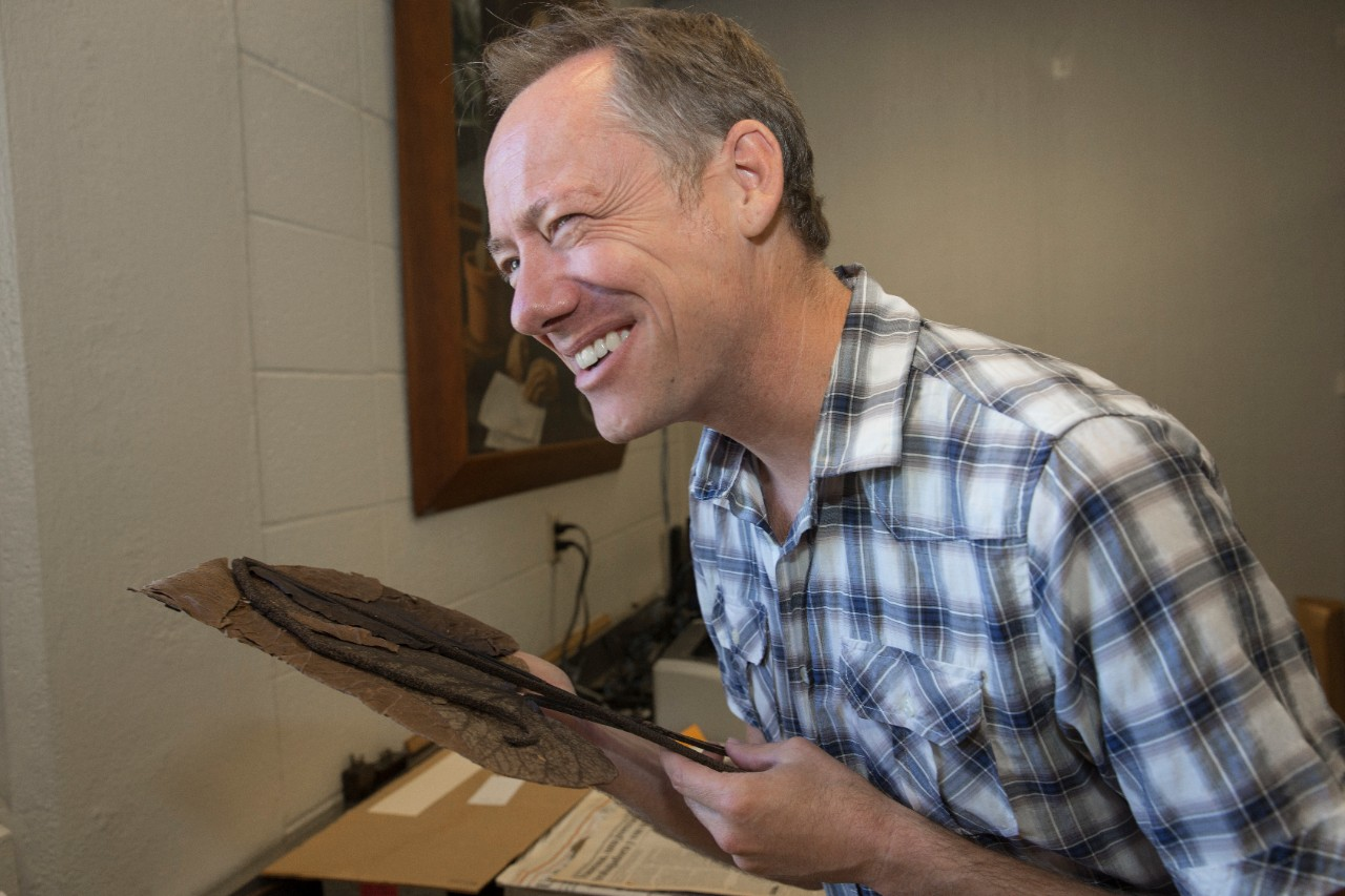 UC biology professor Eric Tepe reacts after smelling a pepper plant.