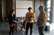 Fourth-year students Caty Tran & Daniel Kruk discuss book layout with Professor Hildebrandt in studio