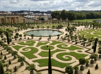 View of gardens in Versailles, France from palace balcony.