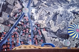 An aerial view of the ground in Goreme, Cappadocia, Turkey from a hot air balloon.
