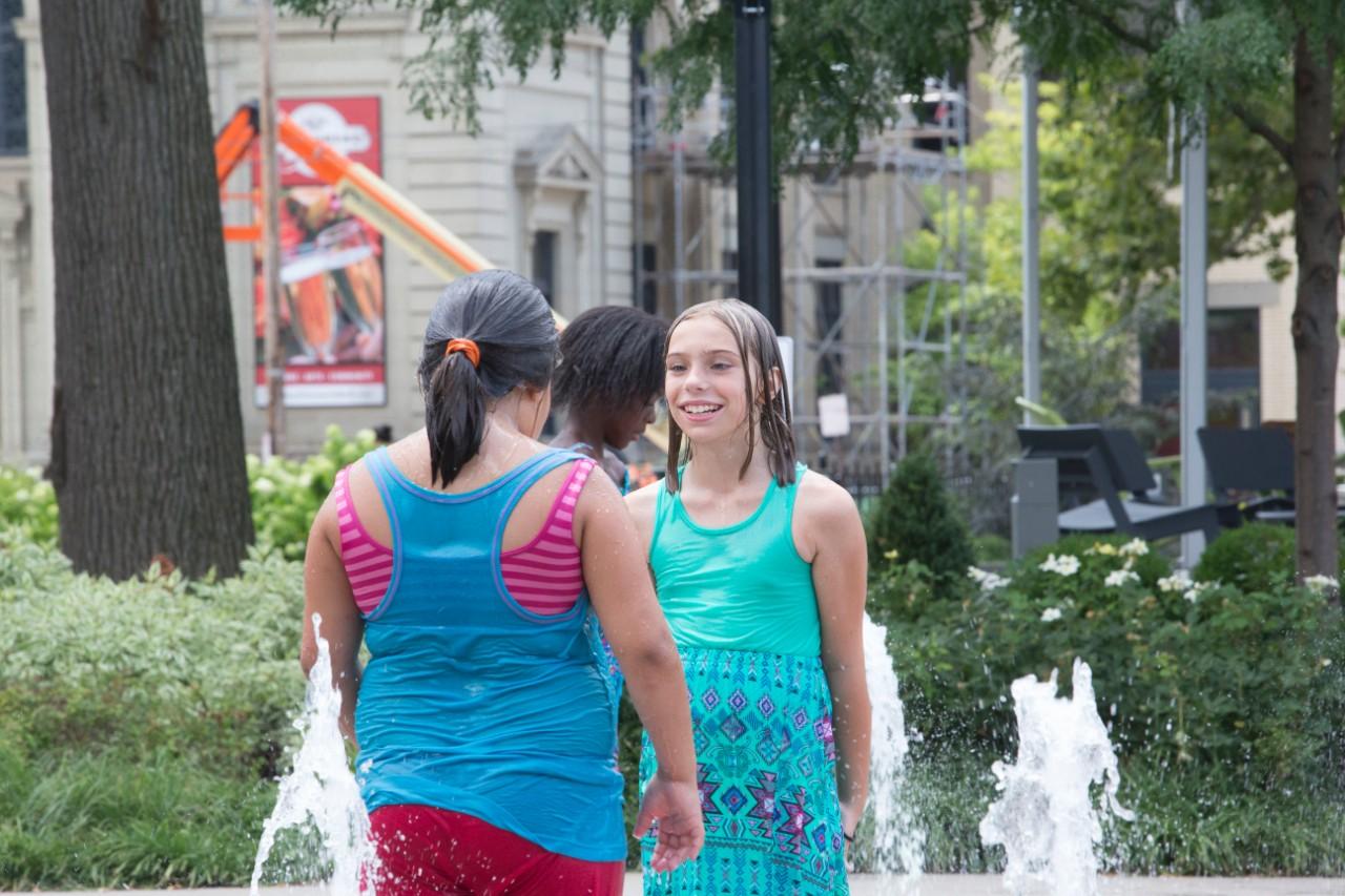 Jacqueline Lawson enjoys the sun and fountains at Washington Park. Photo/Joe Fuqua/UC Creative Services