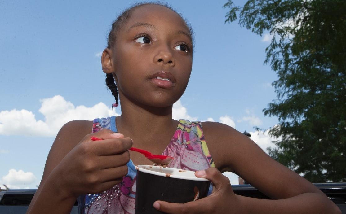 Joli enjoys her ice cream at Washington Park.