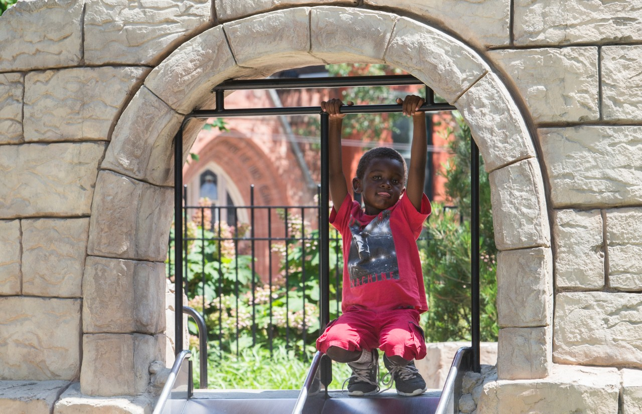 UpSpring summer camper enjoys the sun and fun at Washington Park. Photo/Joe Fuqua/UC Creative Services