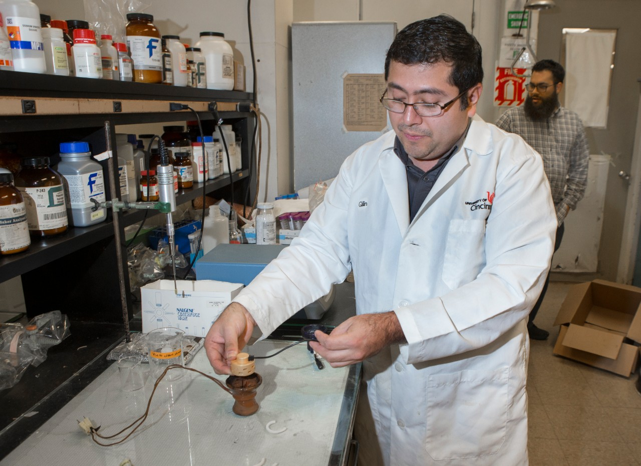UC assistant professor Julio Landero Figueroa shows how electronic charcoal works.