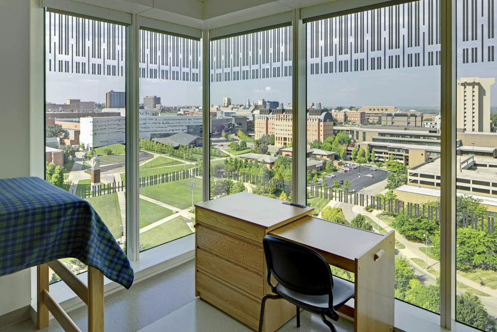 A 2-in-1 dresser-desk sits inside one of Morgens Hall dorms, overlooking Main Campus.