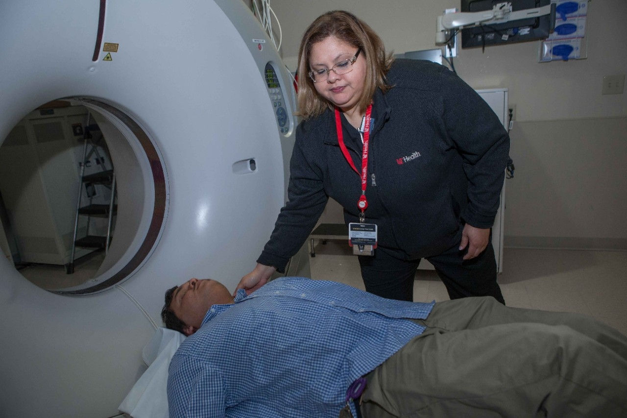 CT technician Jessica Rivera demonstrates a CAT scan at UC Health's West Chester Hospital.