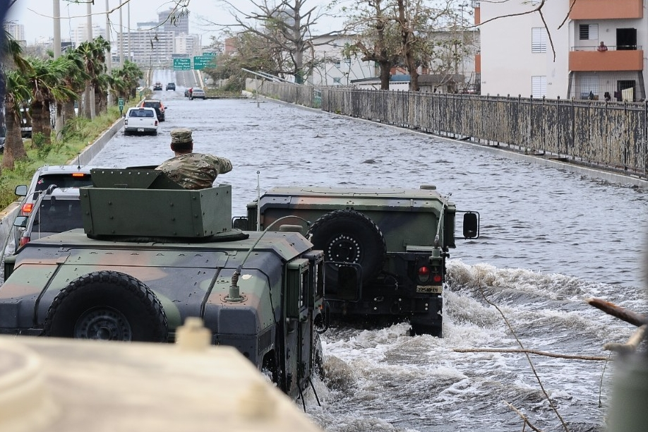 The Puerto Rico National Guard travels over a highway flooded by Hurricane Maria. (Sgt. Jose Ahiram Diaz-Ramos/PNG)