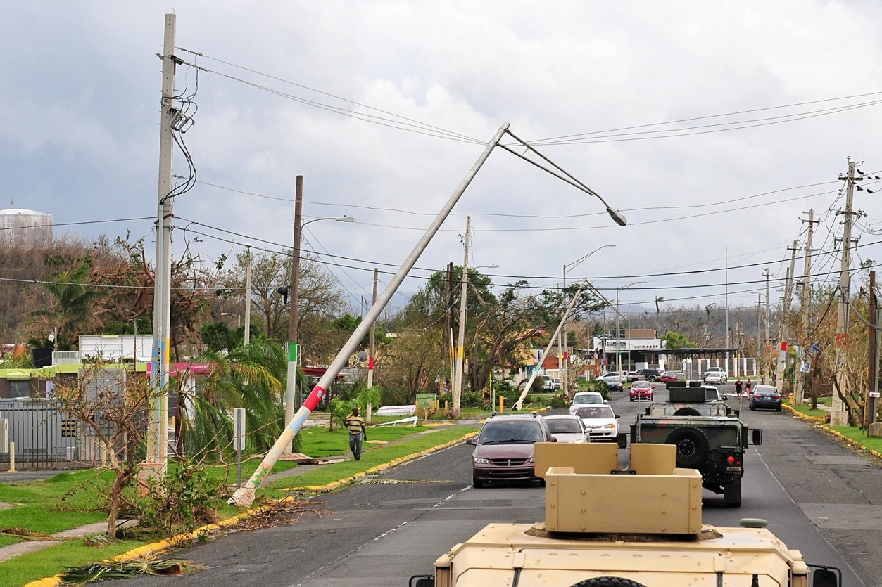 The Puerto Rico National Guard surveys storm damage in Villa Santo after Hurricane Maria. (PNG/Wikimedia Commons)