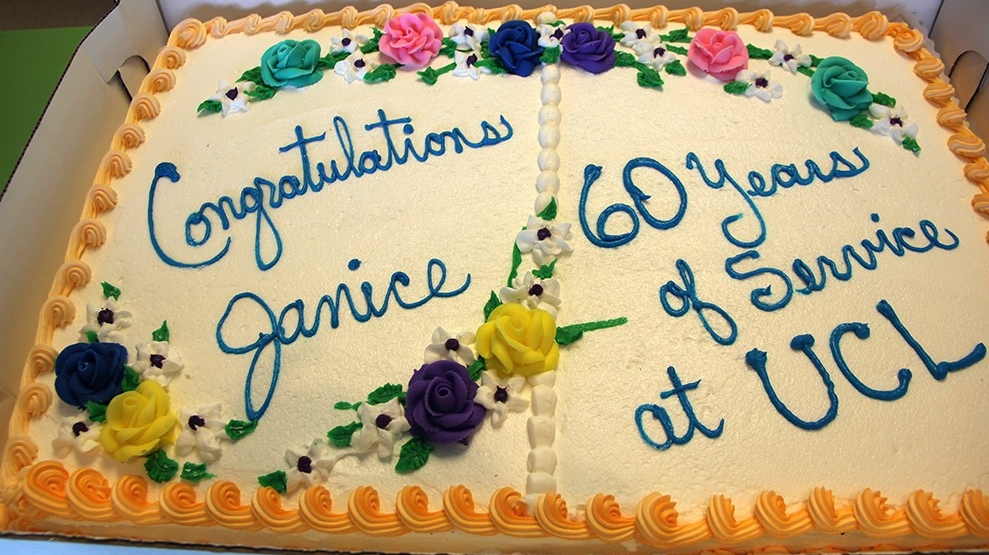 Hutzler's coworkers brought a decorated cake to celebrate her 60th work anniversary