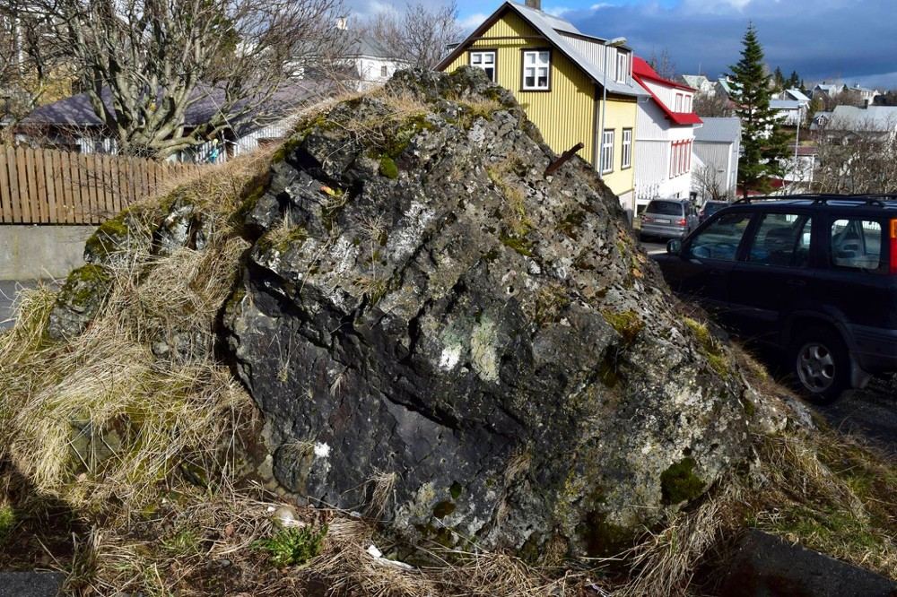 A large rock believed to be inhabited by elves remains in the middle of a road in Iceland.photo/Kevin Grace