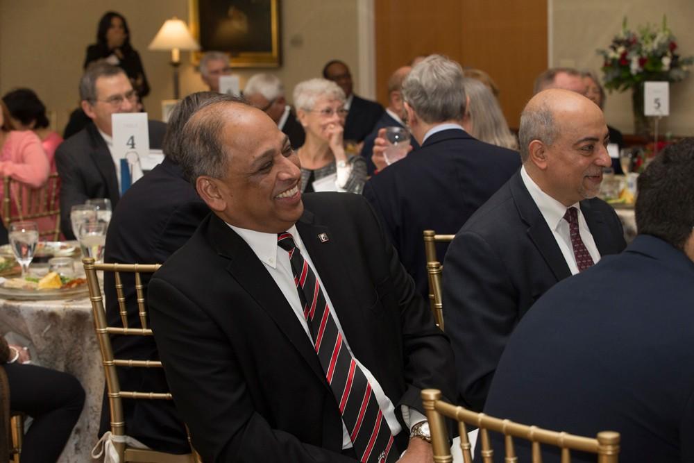 President Pinto enjoy conversation during brunch