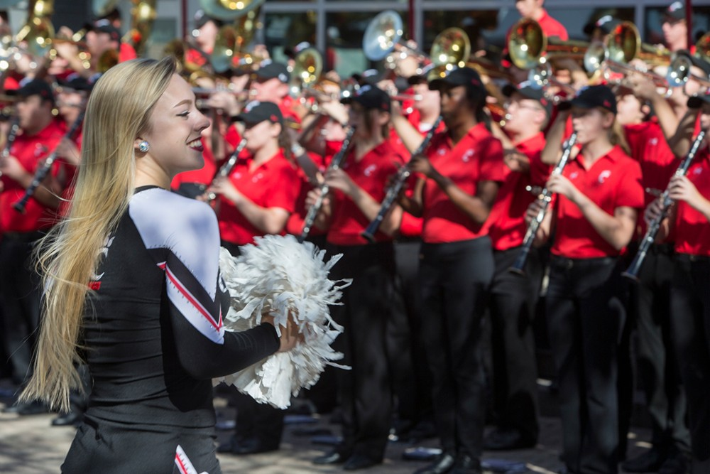UC cheerleaders and the band welcome Neville Pinto during the inauguration ceremony