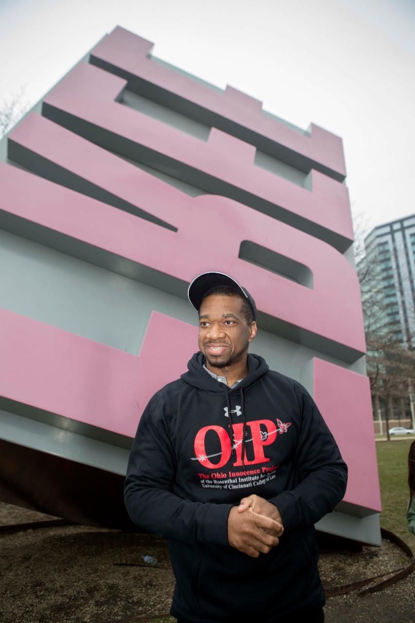 Ru-El Sailor poses in front of Cleveland's iconic Free Stamp after his release from state prison Wednesday. Sailor was the 26th wrongfully convicted defendant released with help from UC's College of Law.