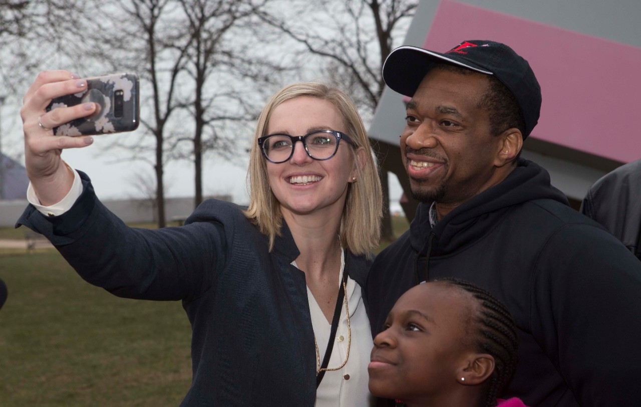 Ru-El Sailor takes a selfie with lawyer Kimberly Kendall Corral in front of Cleveland's Free Stamp monument.