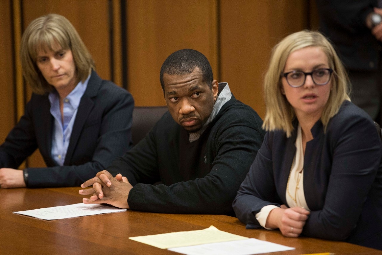 Ru-El Sailor sits at the defense table with UC Law professor Jennifer Bergeron, left, and his defense counsel, Kimberly Kendall Corral.