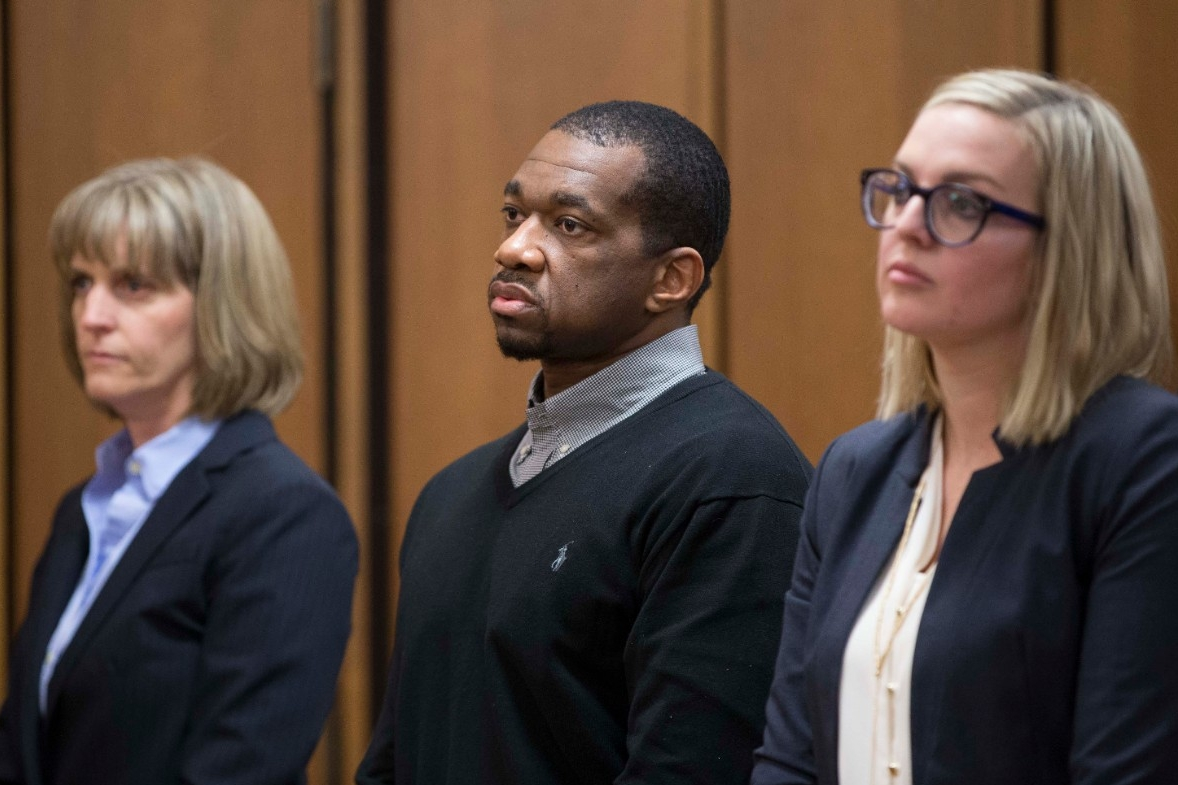 Defendant Ru-El Sailor stands with UC Law professor Jennifer Bergeron, left, and defense counsel Kimberly Kendall Corral while he awaits a judge's verdict.