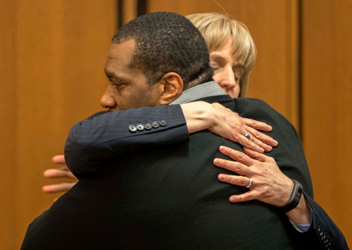 Ru-El Sailor, wrongfully convicted in a 2002 murder, hugs UC Law professor Jennifer Bergeron, who helped win his freedom as part of the Ohio Innocence Project.