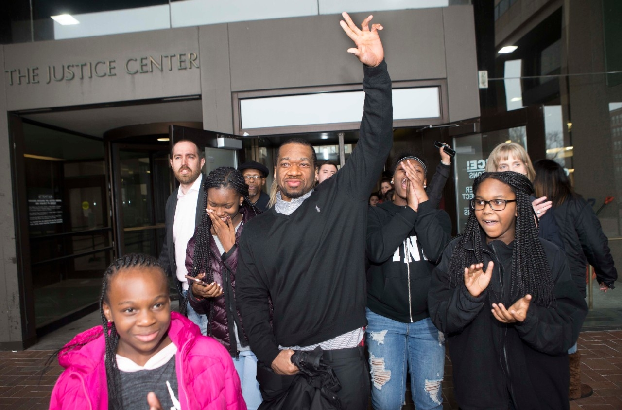 Ru-El Sailor walks out of the Cuyahoga County Courthouse with his family on Wednesday after spending 15 years in prison for a murder he did not commit.