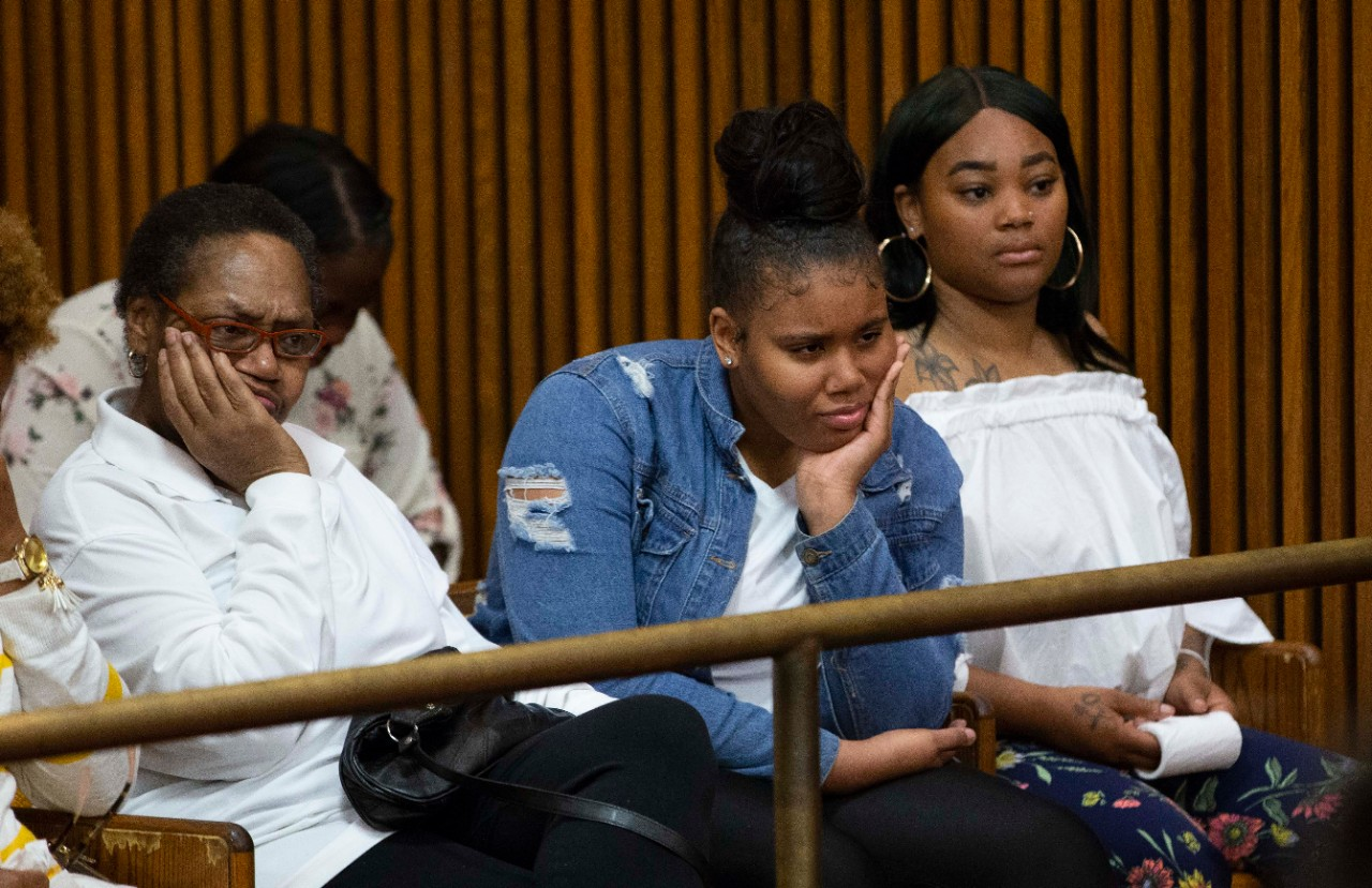 Family members of Christopher Miller listen to proceedings Thursday in Cuyahoga County Common Pleas Court.