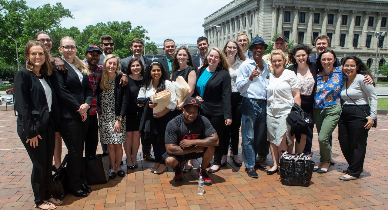 UC College of Law students pose outside the Cuyahoga County Justice Center on Thursday with some of the people they have helped exonerate as part of UC's Ohio Innocence Project.