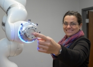 University of Cincinnati professor Tamara Lorenz shows off Tess, a robot she uses in her psychology research.