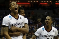 University of Cincinnati Bearcat basketball players celebrate a win over Purdue in the NCAA 2015 tournament.