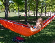UC student in hammock on campus