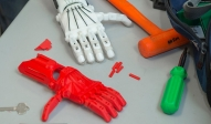 A photo of colorful 3-D printed hands to be used for disabled patients with a need for a prosthetic.